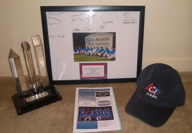 The Rookie All Star trophy the team gave me and the signed picture of the team.